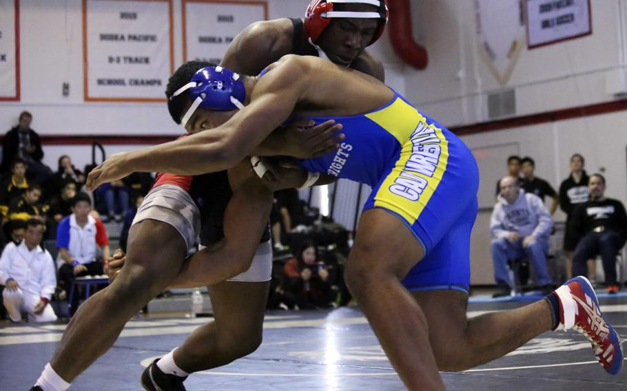 Nile C. Kinnick's Dwayne Lyon and Christian Academy Japan's Lawrence Yamaguchi tangle at 180 pounds during Saturday's Zama Invitational. Defending Far East champion Lyon placed second and Yamaguchi third in the weight class.
