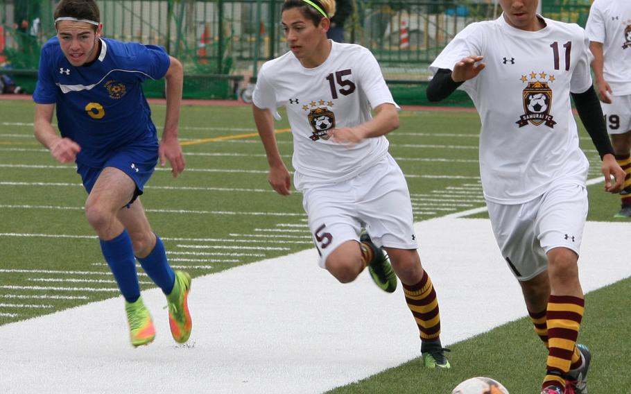 Matthew C. Perry's Colin Ernst leads the charge upfield against Yokota during Saturday's Perry Cup boys soccer match. The Panthers edged the Samurai 1-0 and finished second in the tournament, while host Perry finished fourth.