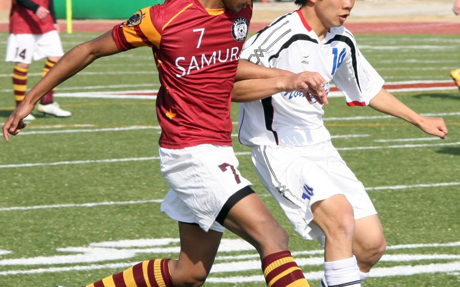 Matthew C. Perry's David Shoebrook, left, chases down the ball during Saturday's Perry Cup boys soccer match. Noda Gakuen won 5-2 and won the tournament. The host Samurai finished fourth.