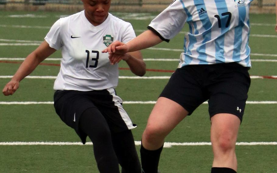 Daegu's Mylisse Spurgon and Osan's Elizabeth White battle for the ball during Saturday's season-opening Korea Blue soccer match, won by the Cougars 5-0.