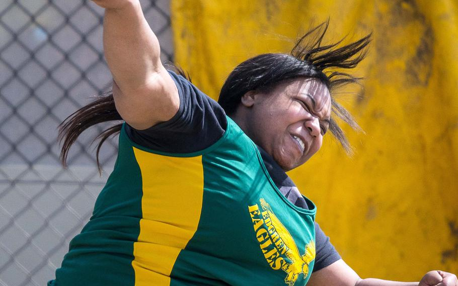 Robert D. Edgren senior Brianna Hunter lets fly with the shot during Saturday's meet at Yokota, breaking her own Pacific record with a throw of 12.33 meters. The transfer from Knob Noster, Mo., broke a 20-year-old Pacific record in the event a week earlier, recording 11.79.