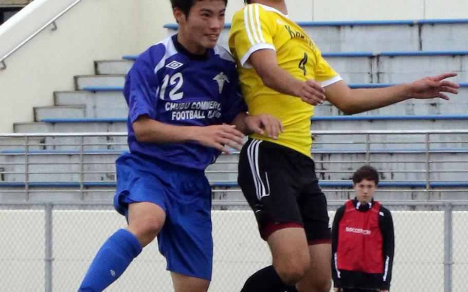 Kadena's Junta Callahan heads the ball against a Chubu Shogyo player during Saturday's boys soccer match, won by the Panthers 7-0.