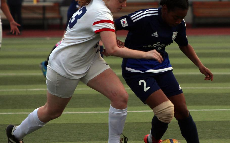 Seoul American's Natalie Cargill and Yongsan's Gracie Parsons battle for the balll during Wednesday's girls soccer match. The visiting Falcons won 6-2.