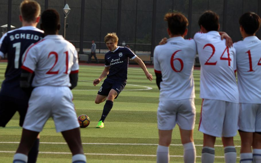 Seoul American's T.J. Carver readies a free kick against the Yongsan's wall during Wednesday's boys soccer match. The host Guardians won 6-4.