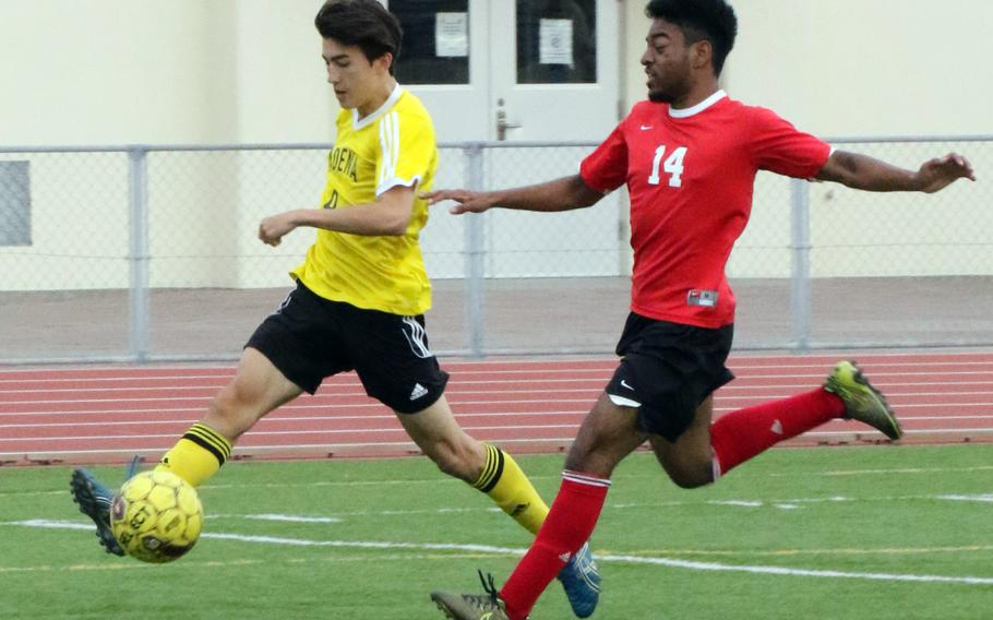 Kadena's Kian Smith dribbles upfield against Okinawa Christian during Wednesday's boys soccer match, won by the Panthers 3-0.