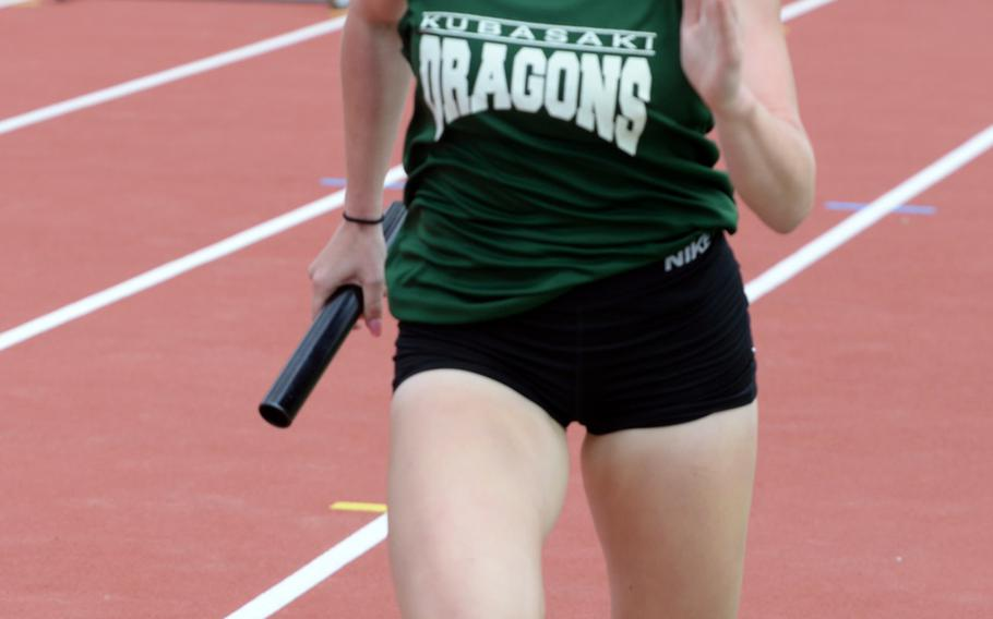 Kubasaki freshman Elizabeth Joy anchors the Dragons to victory in the girls 3,200 relay during Friday's 13th Mike Petty Memorial Track and Field Meet. Kubasaki won in 11 minutes, 25.17 seconds.