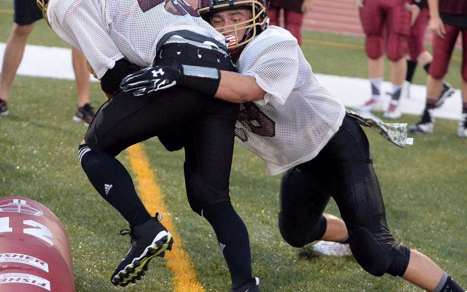 Garrett Macias, right, a senior, returns under center and will line up at free safety for Matthew C. Perry football.