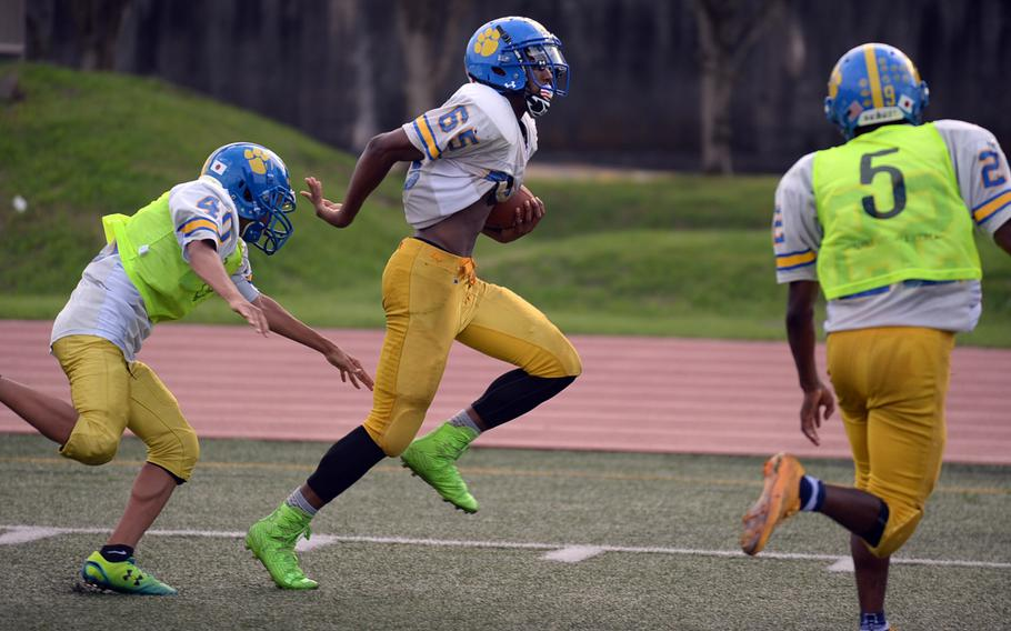 Junior Kishaun Kimble-Brooks, with ball, gives the Panthers foot speed on the outside out of the backfield.