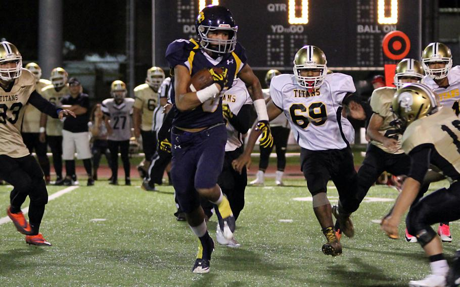 Guam's Makoa Bamba carries the ball against Tiyan during Friday's season-opening game. The Panthers edged the Titans 8-7.