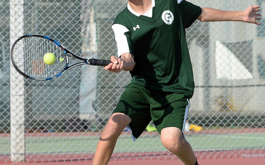 Kubasaki's No. 2 singles seed Shannon Hyde smacks a forehand return against Kadena's Tom Slinger during Tuesday's tennis tie. Hyde won 6-0, 6-1 and the Dragons won the tie 12-2 over the Panthers.