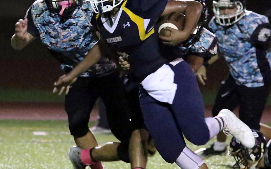 RaSean Jacobs charges past the Southern defense for a Guam High touchdown.