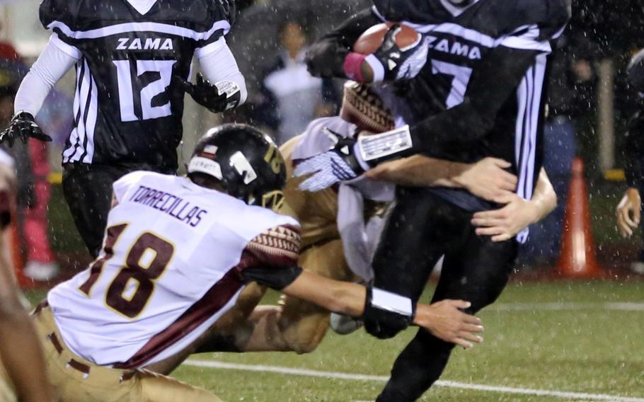Zama ballcarrier Devonte Gabriel tries to weave his way between Matthew C. Perry defenders.