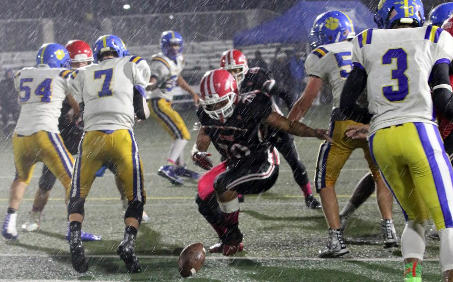 Nile C. Kinnick's Alvin Catabayan chases down a fumble between Yokota opponents.