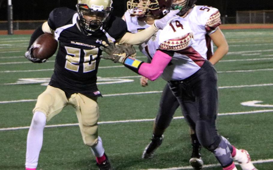 Humphreys running back Josh Weaver tries to elude Matthew C. Perry's Garrett Macias and Mason Graydon during Friday's football game, won by the Samurai 20-10.