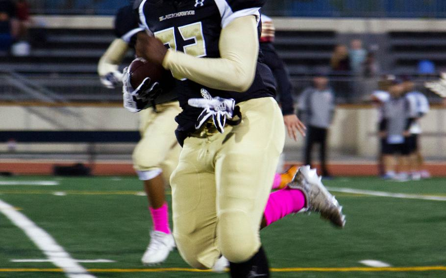 Humphreys sophmore Tyrick Arterberry breaks for a long run against the Matthew C. Perry defense at Camp Humphreys, South Korea, Friday, Oct. 13, 2017. Perry defeated Humphreys 20-10.