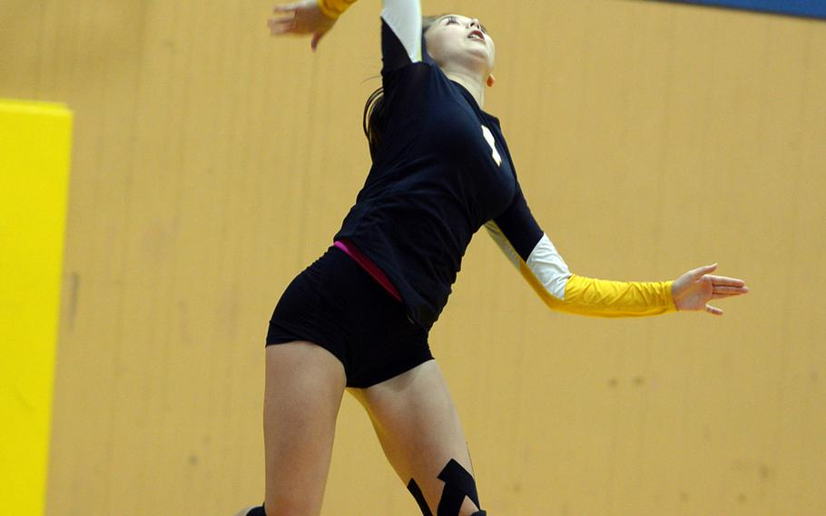 Senior Kiki Davidson serves for American School In Japan against Yokota during Wednesday's volleyball match, won by the Mustangs 25-15, 25-19, 28-26.