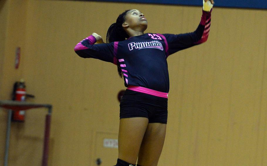 Senior Britney Bailey jump serves for Yokota against American School In Japan during Wednesday's volleyball match, won by the Mustangs 25-15, 25-19, 28-26.
