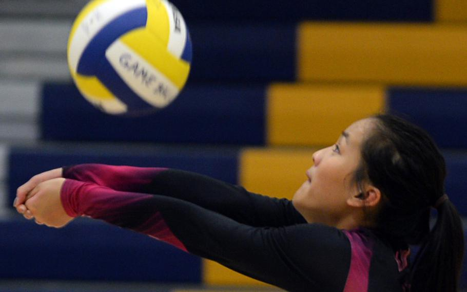 Yokota senior Lianna Bloom bumps the ball against Christian Academy Japan during Tuesday's volleyball match. The Panthers rallied from 2-1 down to beat the Knights 25-17, 21-25, 21-25, 25-14, 15-8 in a rematch of last season's Far East Division II final.