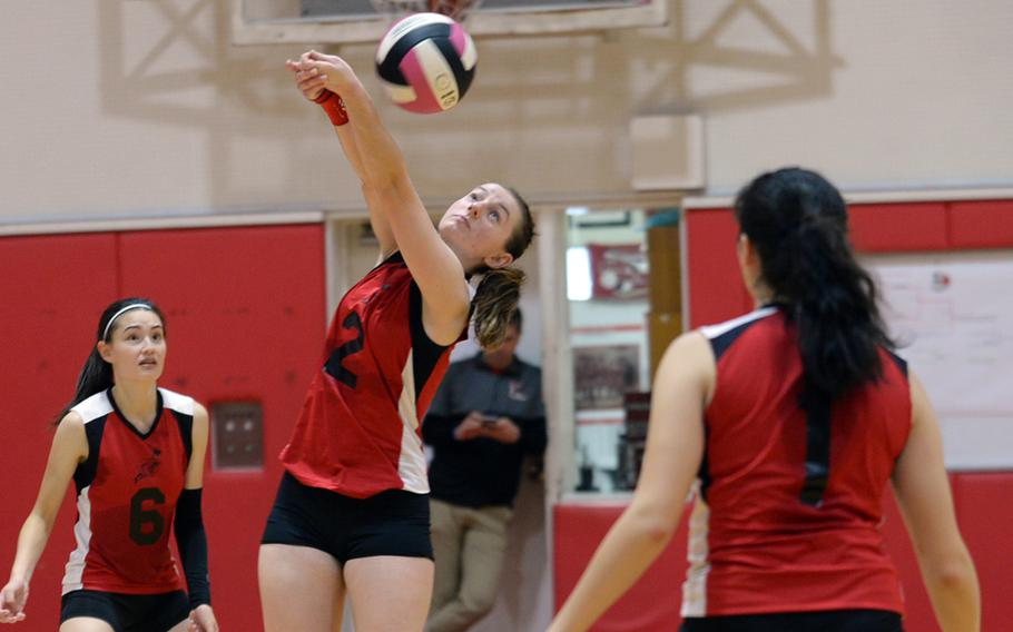 E.J. King's Natalie Schulz bumps the ball over the net against Robert D. Edgren during Friday's DODEA-Japan/Pac-East girls volleyball tournament knockout match, won by the Cobras 25-22, 25-20, 25-22. King advanced to Saturday's elimination match against Zama, needing two wins to reach the final.
