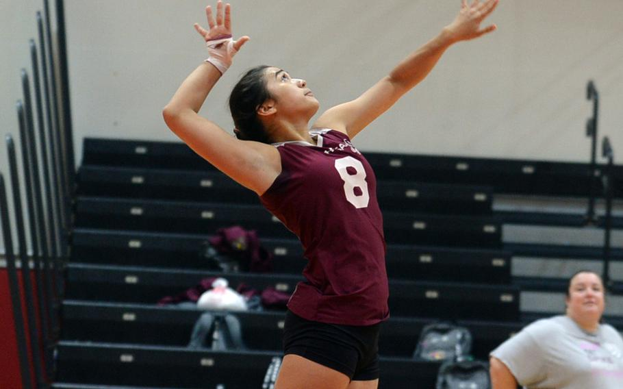 Matthew C. Perry's Hazel Bolduc jump-serves against Zama  during Friday's DODEA-Japan/Pac-East volleyball tournament knockout match, won by the Trojans 25-18, 25-23, 25-19. Zama moved on to play E.J. King in Saturday's first knockout match, needing two wins to reach the final.
