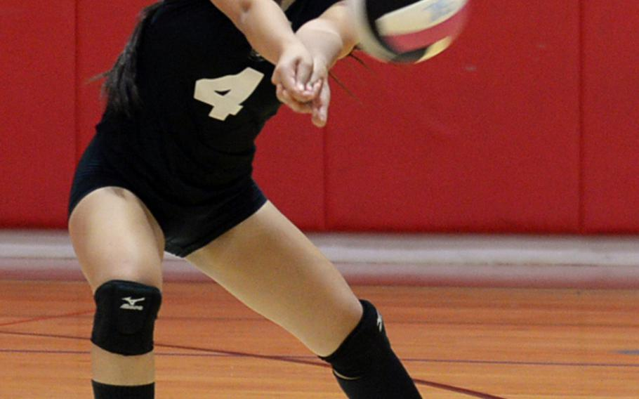 Zama libero Darianne Sanchez digs up a Matthew C. Perry spike during Friday's DODEA-Japan/Pac-East volleyball tournament knockout match, won by the Trojans 25-18, 25-23, 25-19. Zama moved on to play E.J. King in Saturday's first knockout match, needing two wins to reach the final.