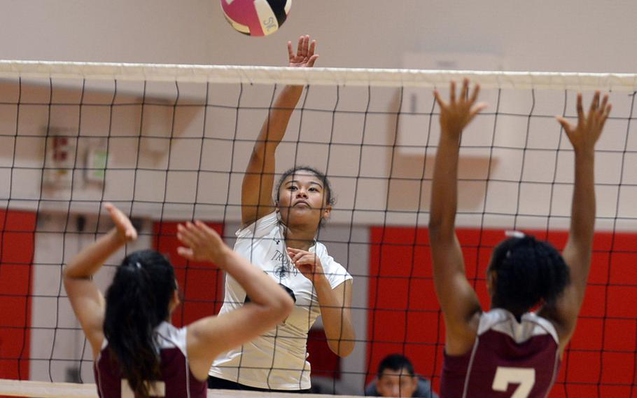 Zama's Grace Bryant smacks a spike over Matthew C. Perry's Anna Garcia and Brie Barrett during Friday's DODEA-Japan/Pac-East girls volleyball tournament knockout bracket match. The Trojans won 25-18, 25-23, 25-19 to advance to Saturday's elimination match with E.J. King.