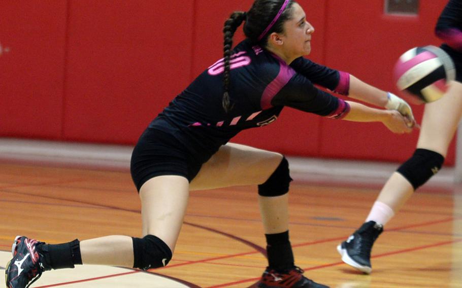 Yokota's Adrianna Diaz lunges to dig a Nile C. Kinnick spike.