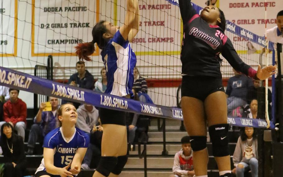 Yokota's Kyra Anderson goes up to swat the ball back over the net against Christian Academy Japan.