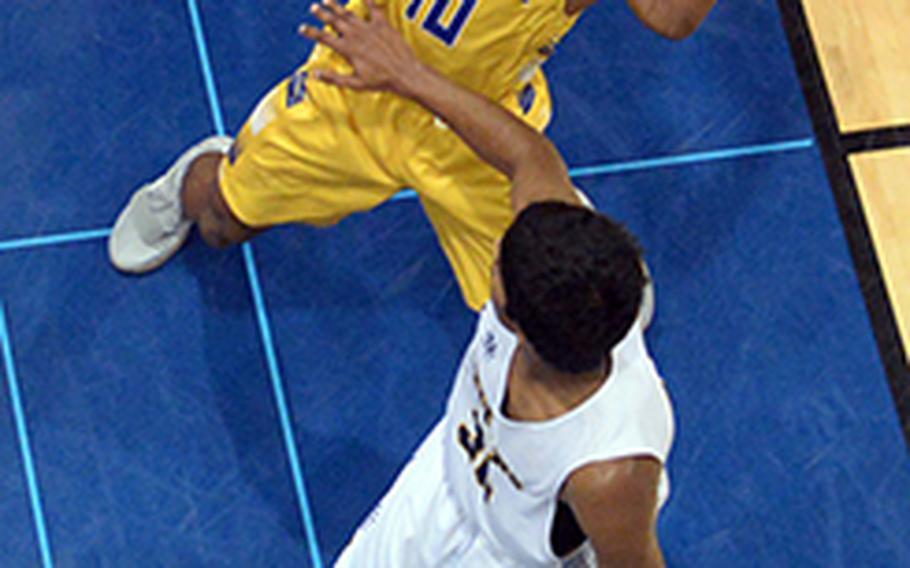 Yokota's Kishaun Kimble-Brooks snatches a rebound away from St. Mary's Satish Karthikeyan during Friday's Japan boys basketball game, won by the Panthers 52-32.