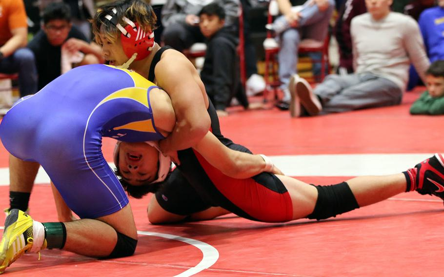 """Nile C. Kinnick's Kameron Leon Guerrero gets the upper hand on St. Mary's Austin Koslow in the 168-pound final during Saturday's 25th Nile C. Kinnick Invitational """"Beast of the Far East"""" Wrestling Tournament. Koslow decisioned Leon Guerrero 12-6."""