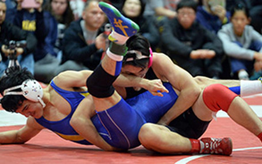 """Nile C. Kinnick's Lucas Wirth gets control of St. Mary's Rio Lemkuil in the 129-pound final of Saturday's 25th Kinnick Invitational """"Beast of the Far East"""" Wrestling Tournament. Wirth won by technical fall 12-2 in 3 minutes, 31 seconds in a battle of former two-time Far East champions."""