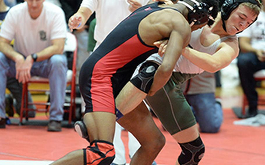 """Nile C. Kinnick's Devoney Stanley lifts the right leg of Kubasaki's Connor Brennan in the 135-pound final of Saturday's 25th Kinnick Invitational """"Beast of the Far East"""" Wrestling Tournament. Stanley pinned Brennan in 1 minute, 53 seconds."""