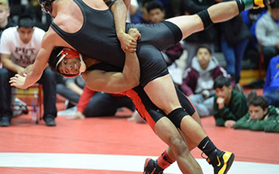 """Nile C. Kinnick's Darius Swenson lifts and scores a two-point throw on Matthew C. Perry's Andrew Borrero in the 158-pound final during Saturday's 25th Nile C. Kinnick Invitational """"Beast of the Far East"""" Wrestling Tournament. Swenson beat Borrero by decision 9-6."""
