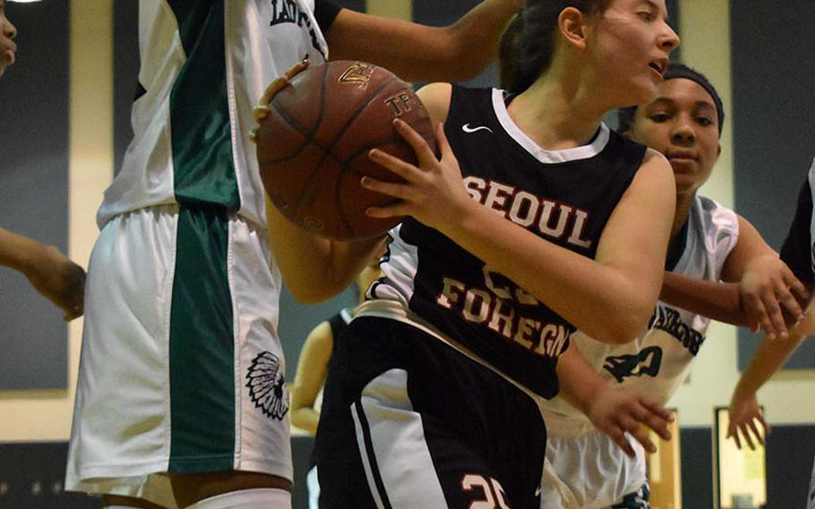Seoul Foreign's Shiraz Ben Shoshan finds herself surrounded by Daegu's DaiJa Turner and Bethani Newbold during Friday's Korea girls basketball game, won by the Warriors 36-31.