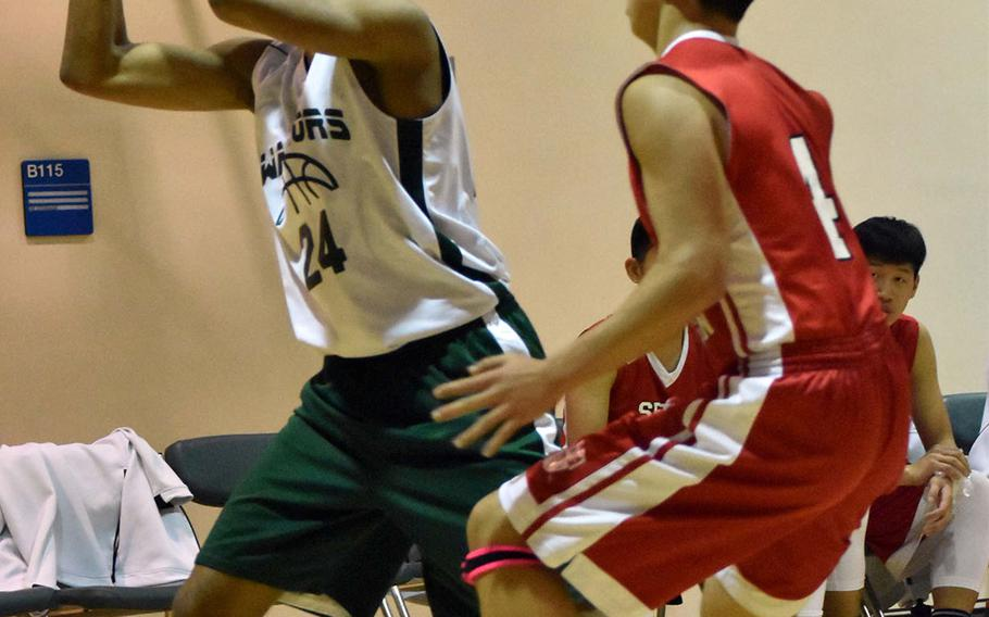 Daegu's Cedric Turner looks to pass against Seoul Foreign's Han Kim during Friday's Korea boys basketball game, won by the Crusaders 59-43.