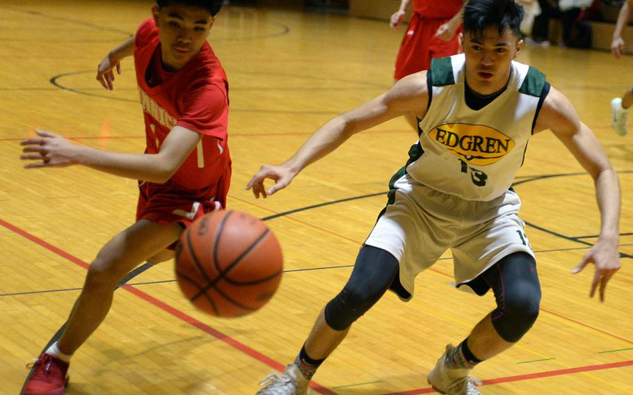 Nile C. Kinnick's Rashad Rapada and Robert D. Edgren's Roman Perez can't find the handle on the ball in Friday's boys pool-play game in the 2nd American School In Japan Kanto Classic Basketball Tournament. The Red Devils routed the Eagles 86-42.