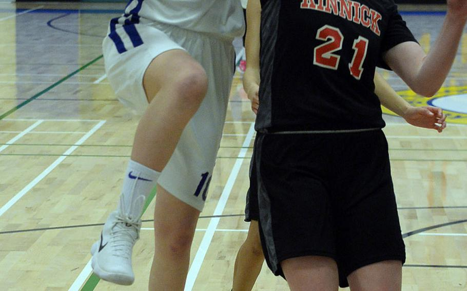 Yokota's Caleigh Garcia drives and shoots against Nile C. Kinnick's Cassi Boyer during Friday's Japan-Kanto Plain girls basketball game. The Panthers won on senior night 51-27 over the Red Devils.