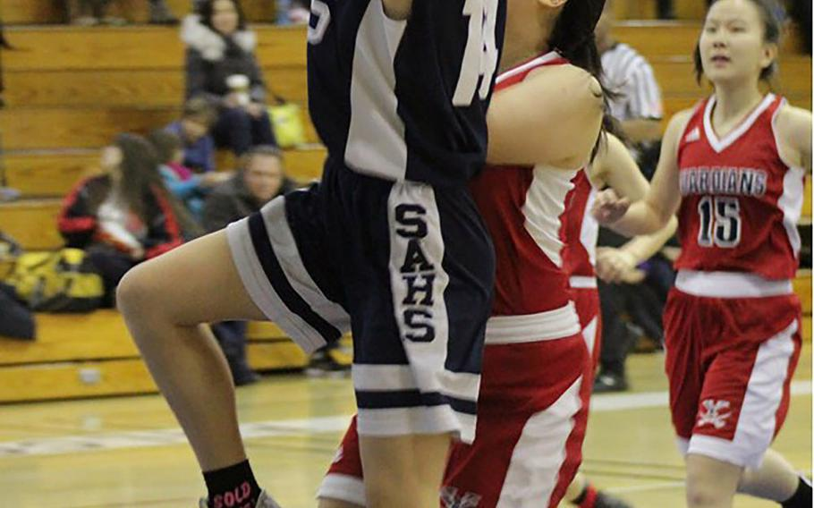 Seoul American's Lauren Kirschner shoots against Yongsan during Saturday's Korea girls basketball game. The Falcons beat the Guardians 50-23 to seal an unbeaten regular season and top seed in next month's Korea Blue Tournament at Osan.