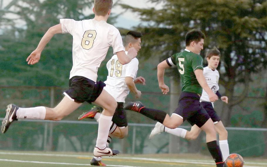 Daegu's Miciah Ruff heads downfield en route to the team's lone goal, with Humphreys' Teige Heckenlaible, Jason Holcomb and Sam Lister in his wake, during Friday's Korea boys soccer match. The Blackhawks won 4-1.