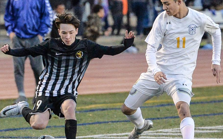 Matthew C. Perry's Brad Ponsiano gets set to kick the ball as Yokota's Manny Mptias defends during Friday's Japan boys soccer match. The Samurai and Panthers played to a 3-3 draw.