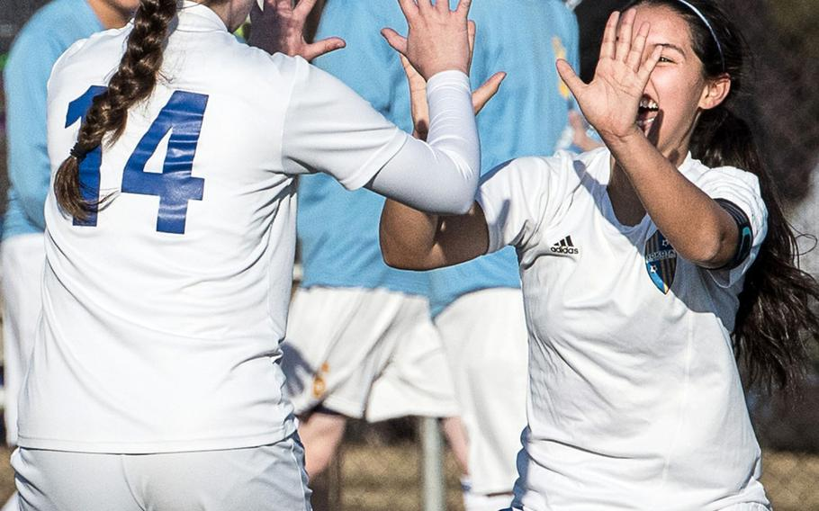 Yokota's Caleigh Garcia and Gina Dukat celebrate a goal during Friday's Japan girls soccer match. The host Panthers routed Matthew C. Perry 7-1.