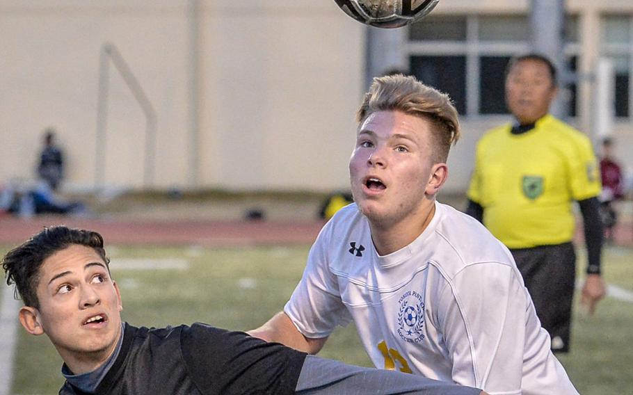 Matthew C. Perry's Lorenzo Hernandez and Yokota's Eli Newton eye the ball during Friday's Japan boys soccer match. The Samurai and Panthers played to a 3-3 draw.