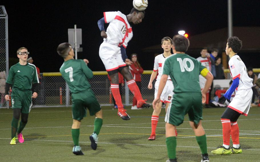 Nile C. Kinnick's Akimanzi Siibo skies to head the ball between teammates and Robert D. Edgren foes during Friday's DODEA-Japan boys soccer match. The Red Devils blanked the Eagles 6-0.
