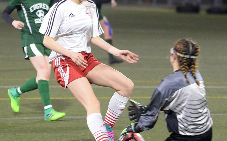 Nile C. Kinnick's Ella Eisenhardt can't get to the ball in time to shoot as Robert D. Edgren keeper Jasmine Johnson makes the stop during Friday's DODEA-Japan girls soccer match. The Red Devils clipped the Eagles 7-1.