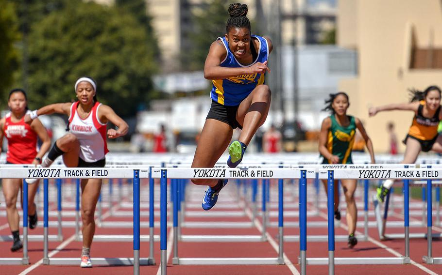 Yokota senior Britney Bailey, the defending league and Far East champion, pulls away to victory in 16.51 seconds in the 100 hurdles during Saturday's season-opening DODEA-Japan and Kanto Plain track and field meet.