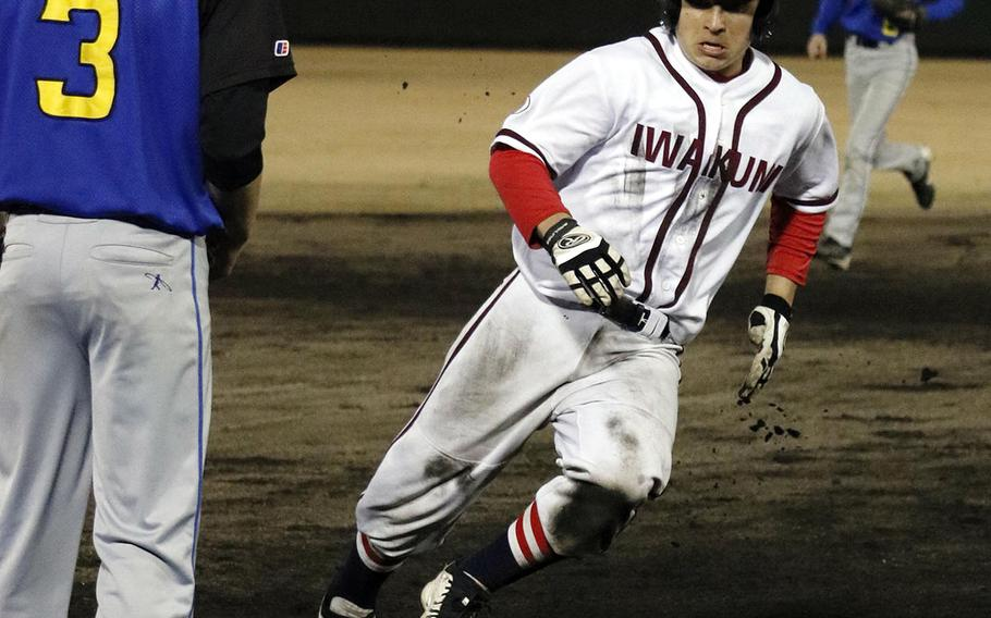 Matthew C. Perry's Zach Greulich dashes around third base headed for home against Yokota during Friday's DODEA-Japan baseball game. The Panthers edged the Samurai 4-2.