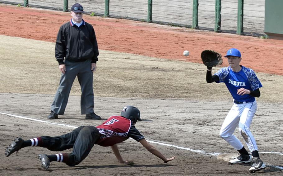 Yokota first baseman Luke Wiedie awaits the pickoff throw as Matthew C. Perry baserunner Justin Andres dives back to first during Saturday's DODEA-Japan baseball game. The Panthers routed the defending Far East Division II Tournament champion Samurai 16-0.