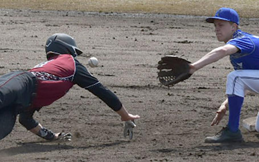 Matthew C. Perry baserunner Garrett Macias tries to slide back to second base ahead of a pickoff throw to Yokota shortstop Jack Winkler during Saturday's DODEA-Japan boys baseball game. Andres was safe on the play. The Panthers won 16-0.