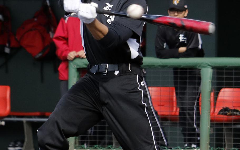 E.J. King's Eric Sasaki takes his cuts against Yokota during Saturday's DODEA-Japan baseball game. The Panthers won 14-3.