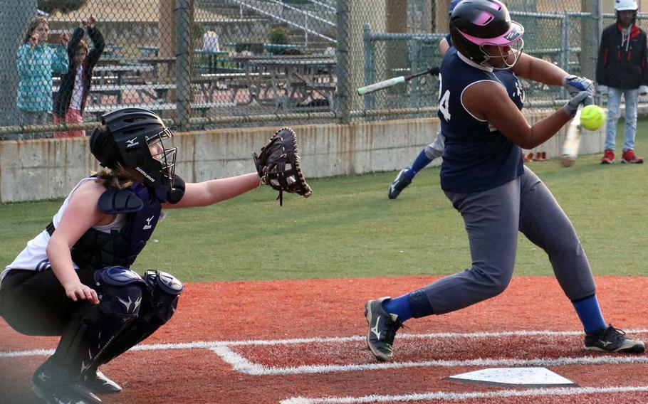 Seoul American's Krista Bradley connects with the pitch in front of Daegu catcher Ariel Lorts. The Warriors won Saturday's DODEA-Korea softball game 14-7.